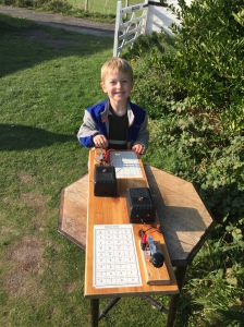 Learning about morse code. He was able to follow the chart to tap out his name.