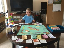Practicing adding and subtracting with Monopoly money