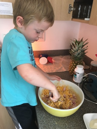 Mixing ham and cheese muffins