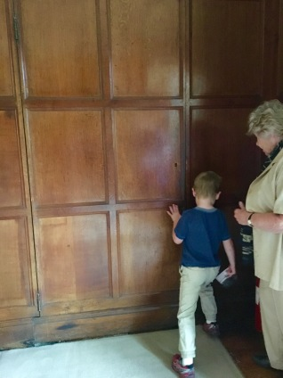 Trying to unlatch the secret door